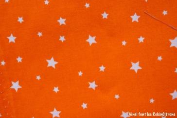 tissu orange etoiles detail