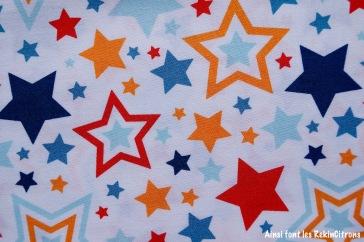 tissu riley blake etoiles rouge orange bleu detail